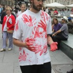 one person wearing white t-shirt with red hand prints