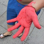 person showing a red hand