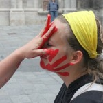 a person gets a red hand print on her face